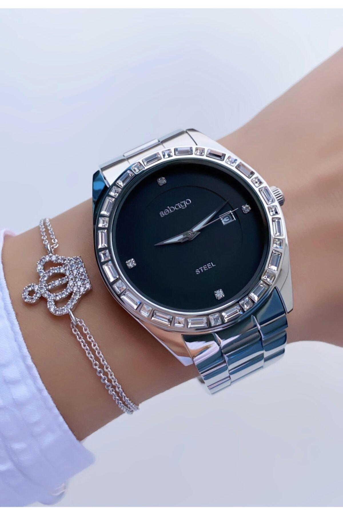 Sebago Kadın Gümüş Renk Siyah Kadran Büyük Kasa Taşlı Model Çelik Kol Saati 1