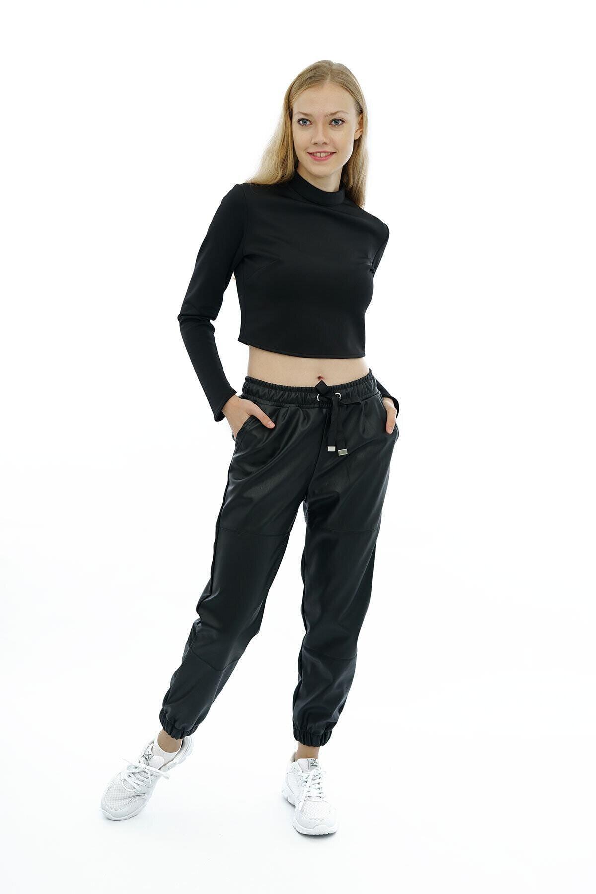 BEBE PLUS Kadın Siyah Beli Ve Paçası Lastikli Deri Pantolon 1