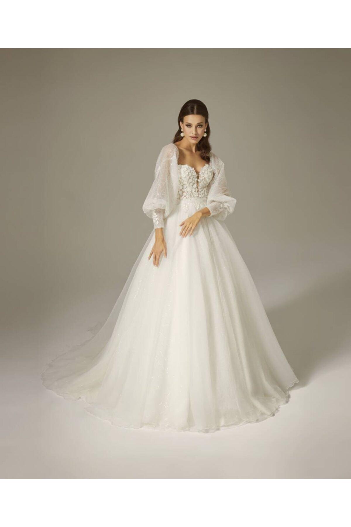 Mediha Cambaz Bridal Oly Balon Kollu Manşet Detaylı 3 Boyut Yaprak Dantelli Yırtmaçlı A Kesim Gelinlik Modeli 1