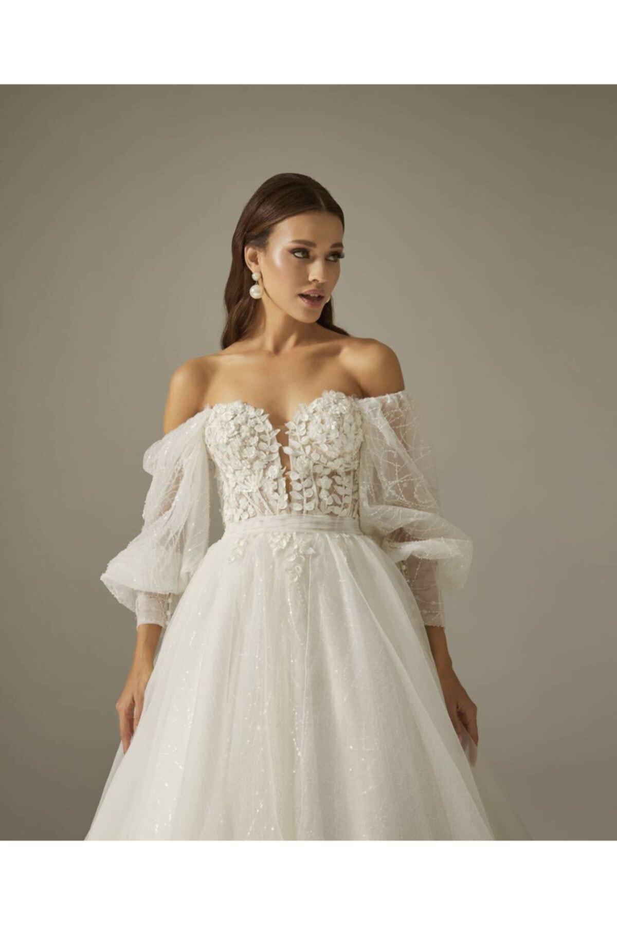 Mediha Cambaz Bridal Oly Balon Kollu Manşet Detaylı 3 Boyut Yaprak Dantelli Yırtmaçlı A Kesim Gelinlik Modeli 2