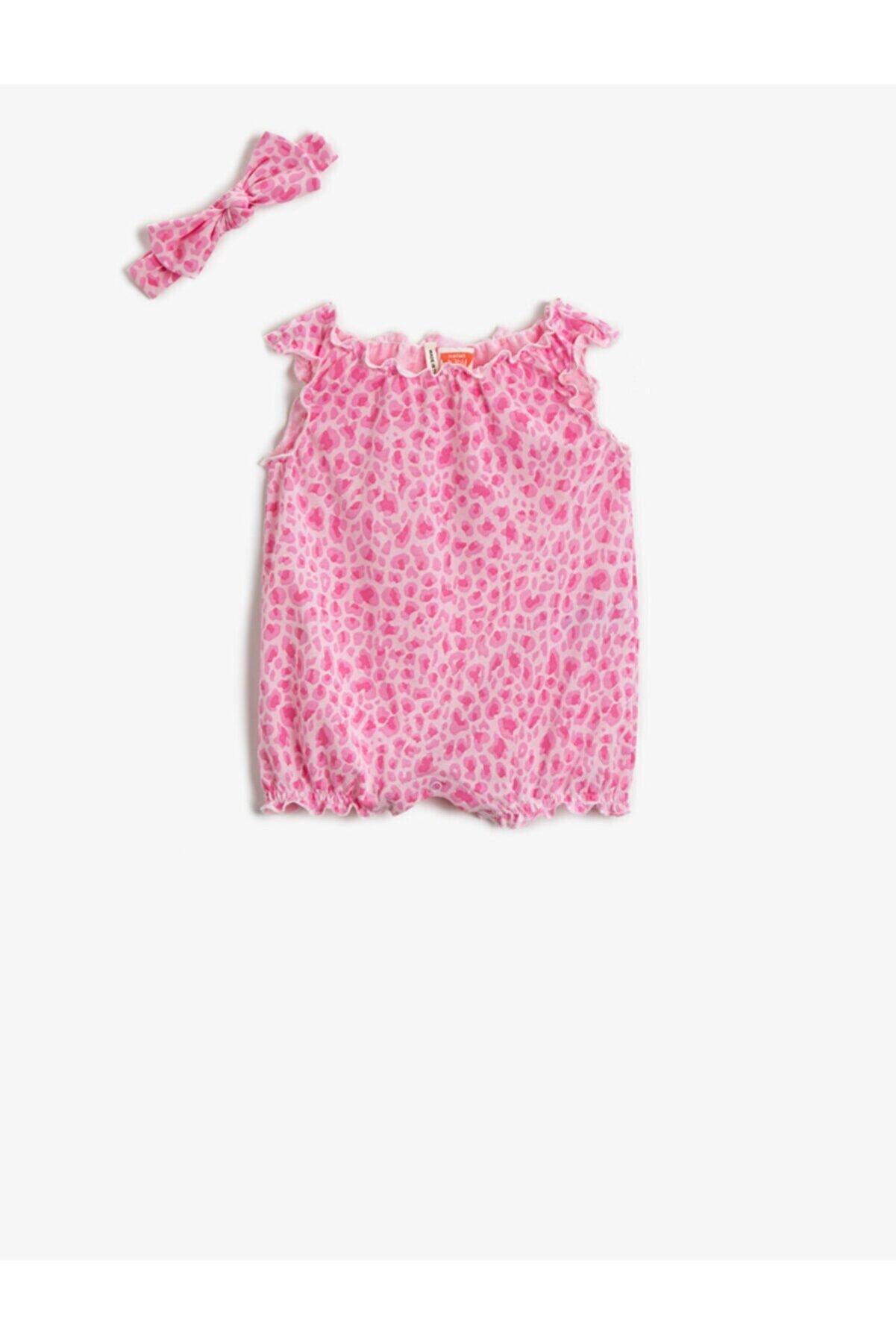 Koton Kız Bebek Pembe Desenli Tulum Çitçitli Pamuklu Saç Aksesuarli