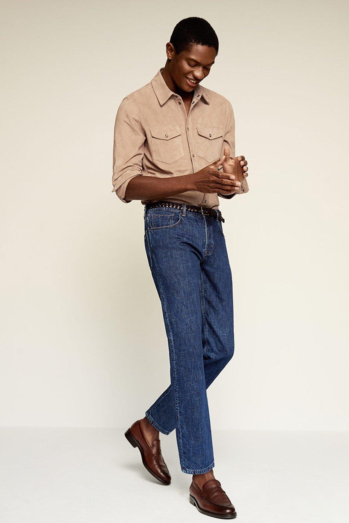 Mango Erkek Donuk Mavi Paçaya Doğru Daralan Kesimli Koyu Yıkama Soft Jean Pantolon 67082877