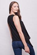 Jument Kadın V Yaka Kolsuz Yakası Aksesuarlı Eteği Asimetrik Bluz -siyah