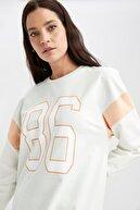 Defacto Kadın Turkuaz Yazı Baskılı Renk Bloklu Sweat Tunik U3526AZ21SMTR