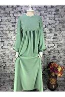 Yuşen Tesettür Kadın Tesettür Önü Fermuarlı Kolları Lastikli Geniş Kalıp Elbise