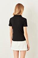 TRENDYOLMİLLA Siyah Düğme Detaylı Fitilli Örme Bluz TWOSS19FV0084