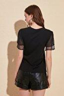 TRENDYOLMİLLA Siyah Kolları Tül ve Volan Detaylı Örme Bluz TWOSS20BZ0720
