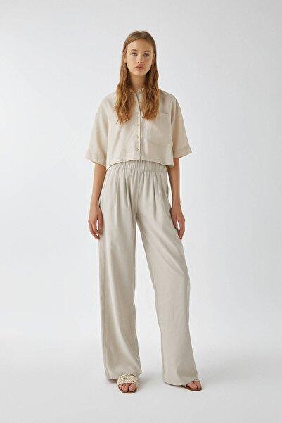 Pull & Bear Kadın Kum Rengi Dökümlü Paperbag Pantolon 09672314