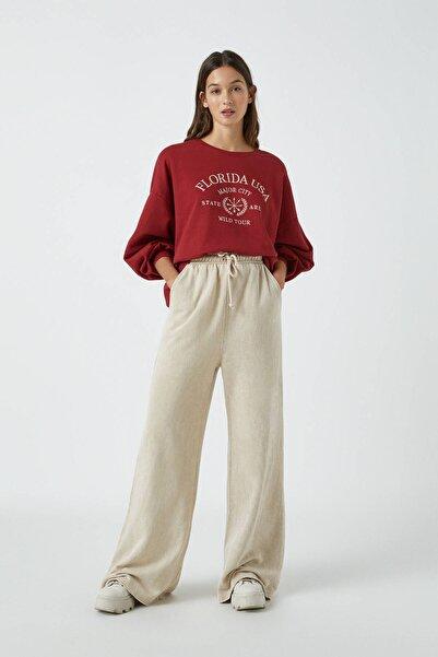 Pull & Bear Kadın Kum Rengi Soluk Efektli Geniş Paça Jogging Fit Pantolon 09678427