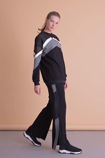xGIZIA Kadın Siyah Yırtmaç Detaylı Bol Paça  Spor Pantolon