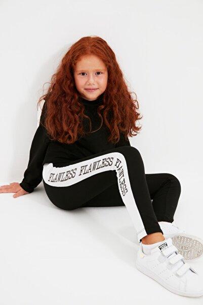 TRENDYOLKIDS Siyah Slogan Baskılı Kız Çocuk Örme Tayt TKDAW22TA0069