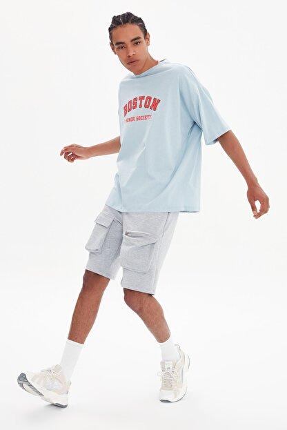 TRENDYOL MAN Mavi Erkek Oversize Bisiklet Yaka Kısa Kollu Baskılı T-Shirt TMNSS21TS1217
