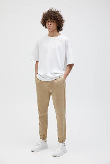 Pull & Bear Erkek Bej Büzgü İpli Basic Jogging Fit Pantolon - En Az %50 Organik Pamuklu 04676525